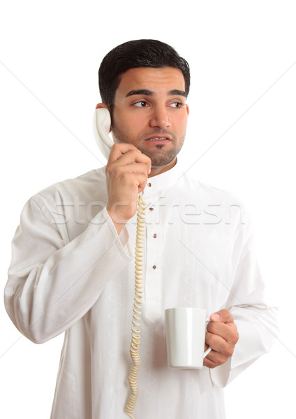 Stock photo: Business dilemma - worried man on phone