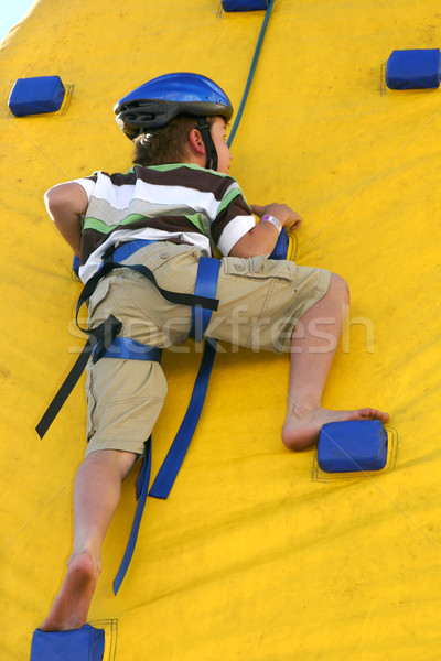 Stock photo: Child climbing a climbing wall