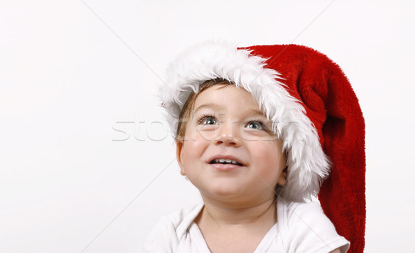 Christmas Wishes. A little boy looking up expectantly with a smile - Room for copy