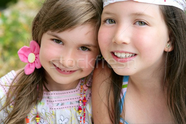Stock photo: closeup portrait of two little girl sisters
