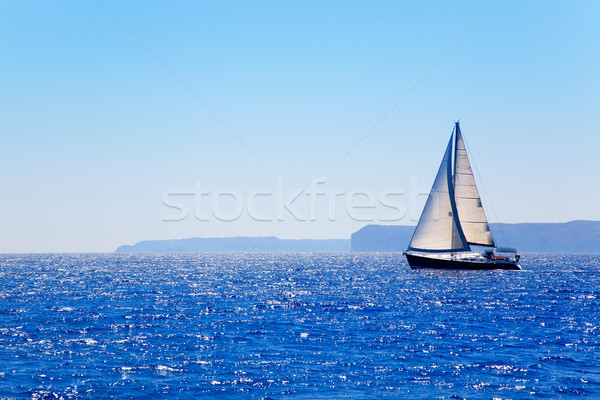 Stock photo: Blue Mediterranean sailboat sailing