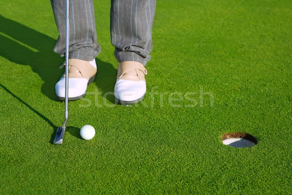 Stock photo: Golf green hole course man putting short ball