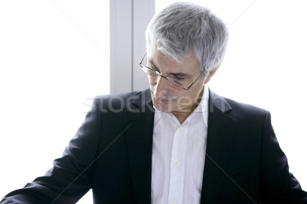 Stock photo: businessman senior gray hair looking down