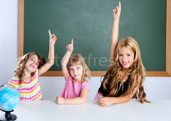 Stock photo: kids student clever girls in classroom raising hand