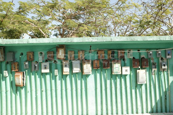 Stock photo: electricity meter wall in mexico outdoor green