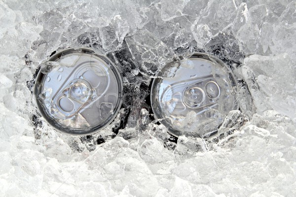 Stock photo: two drink can iced submerged in frost ice