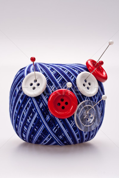 Stock photo: pins in wool ball with buttons