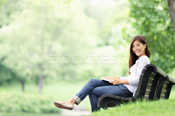 Stock photo: Park woman reading on bench