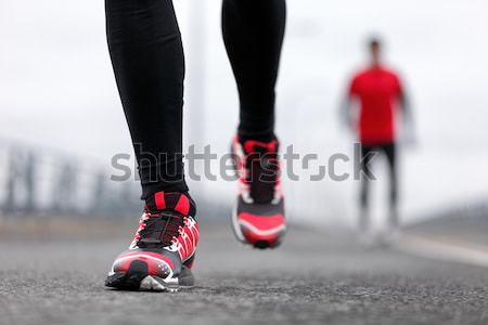 Stock photo : Running shoes in snow with grip soles or traction cleats