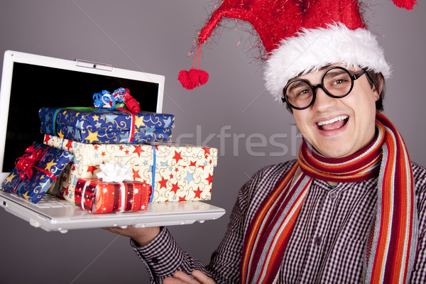 Stock photo: Funny men in christmas cap with gift boxes and notebook