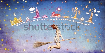 Stock photo: Redhead girl dreaming about traveling around the world.