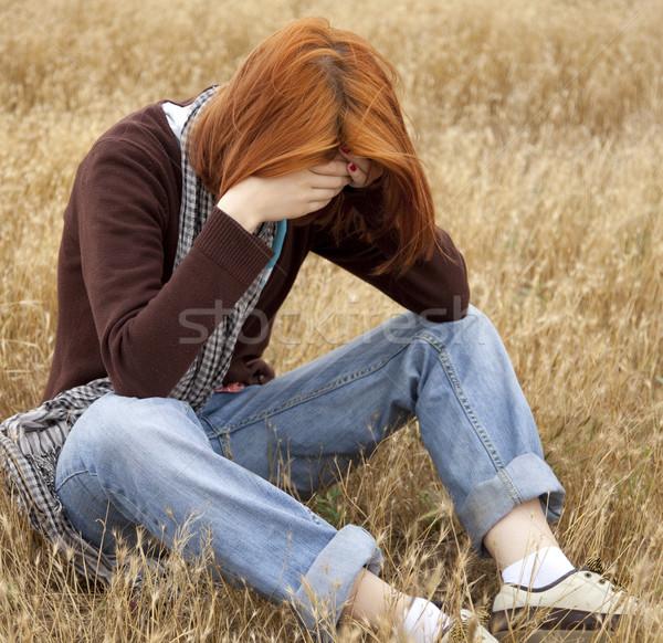 http://stockfresh.com/files/m/massonforstock/m/34/875019_stock-photo-lonely-sad-red-haired-girl-at-field.jpg