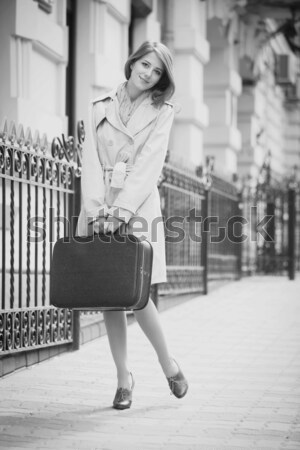 Stock photo: Style girl sitting in the chair in the cafe. Photo in black and