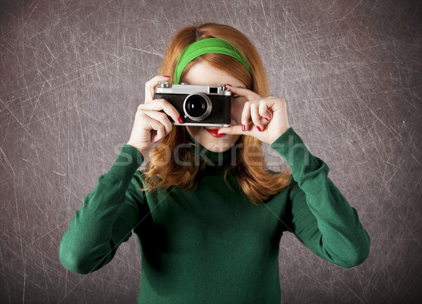 Stock photo: American redhead girl with camera.
