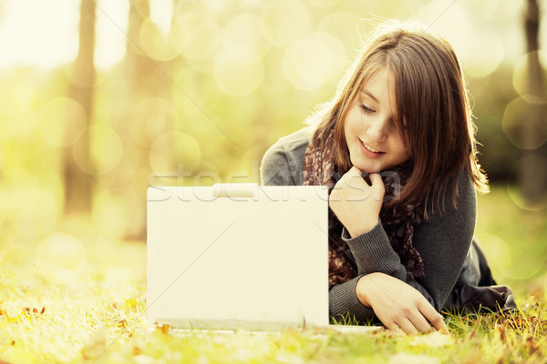 Stock photo: Beauty girl with laptop outdoors