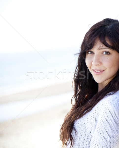 Stock photo: Pretty young woman with standing on beach