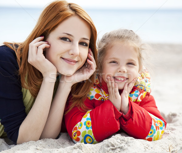 Stock photo: Two sisters at the beach in spring day.