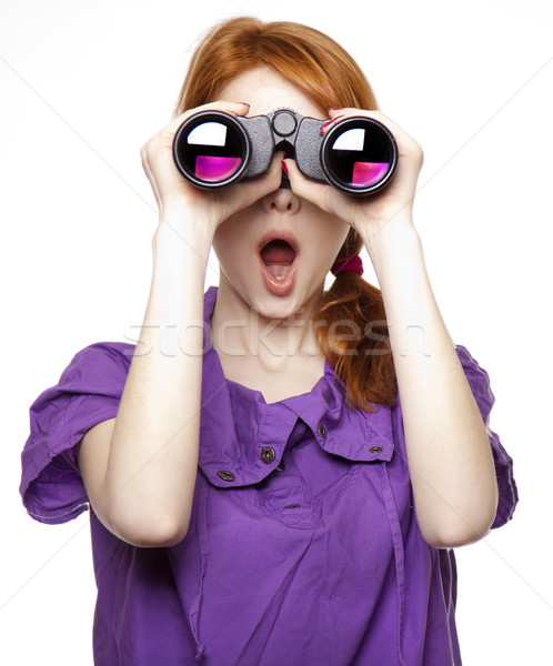 Stock photo: Teen red-haired girl with binoculars isolated on white backgroun