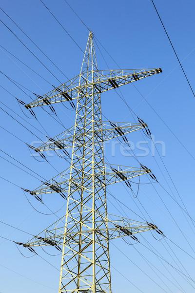 electricity pylon under blue sky