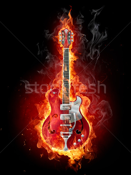 Stock photo: Flaming rock guitar