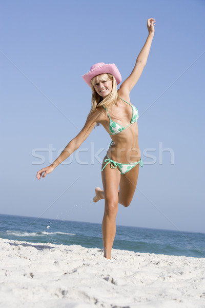 Stock photo: Young woman on beach holiday