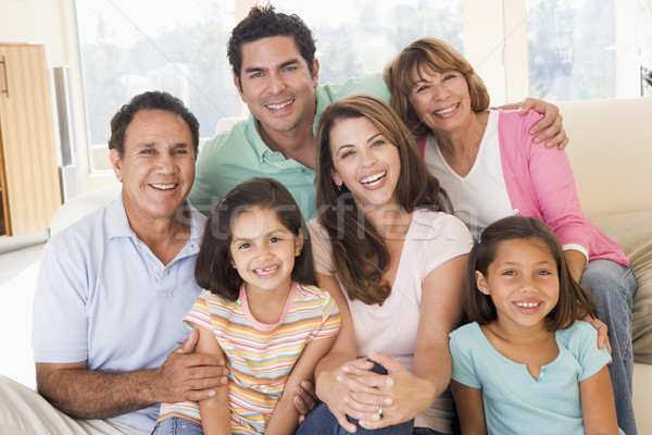 Stock photo: Extended family in living room smiling