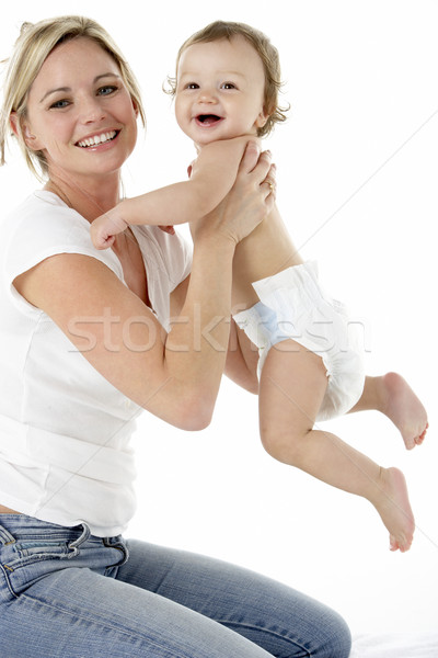 Stock photo: Studio Portrait Of Mother With Young Baby Boy