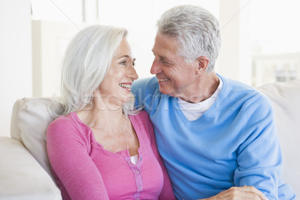Stock photo: Couple relaxing in living room and smiling