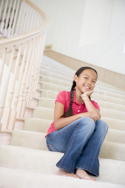 Stock photo: Young Girl Sitting On A Stairwell At Home