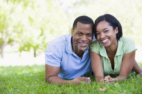Stock photo: Couple lying outdoors smiling