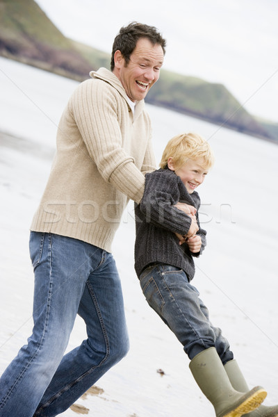 Stock photo: Father holding son at beach smiling