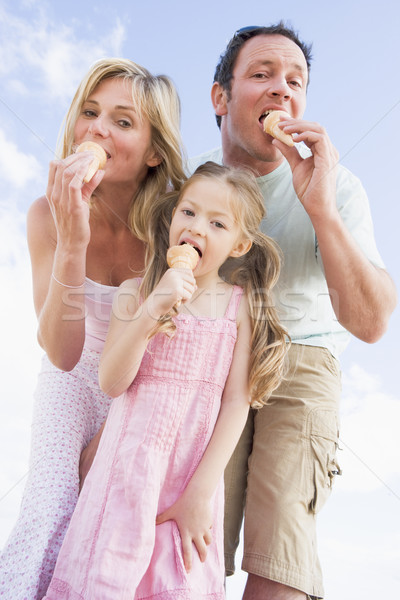 Stock photo: Family standing outdoors with ice cream