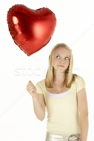 Stock photo: Teenage Girl Holding Heart-Shaped Balloon