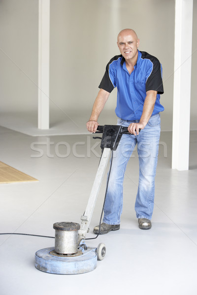 Stock photo: Cleaner polishing office floor