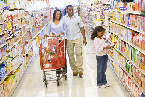 Stock photo: Family grocery shopping