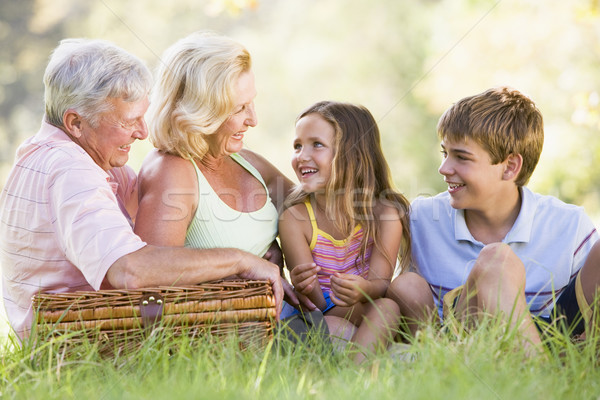 Stock photo: Grandparents having a picnic with grandchildren