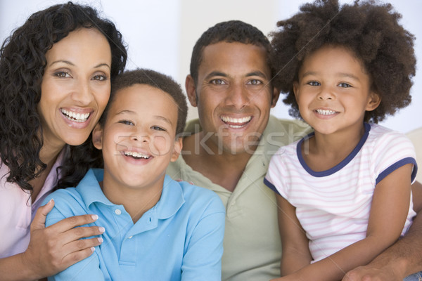 Stock photo: Family in living room smiling