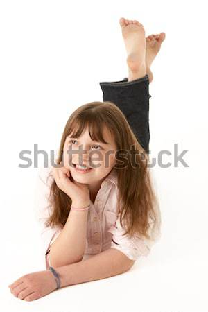 Stock photo: Young Girl Lying On Stomach In Studio