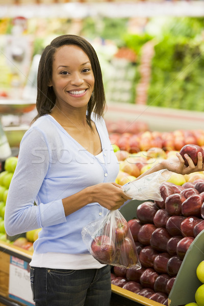 Stock photo: Young woman shopping for fresh produce