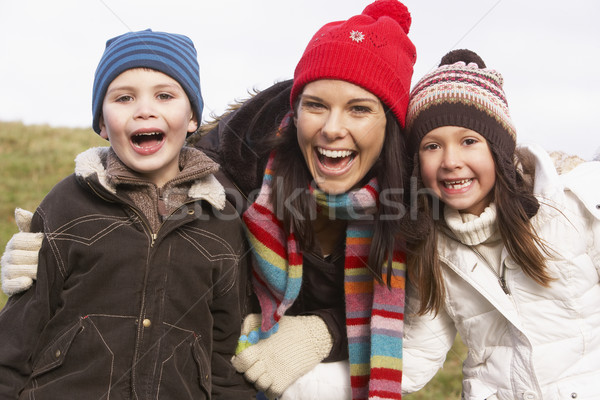 Stock photo: Mother And Her Children Smiling