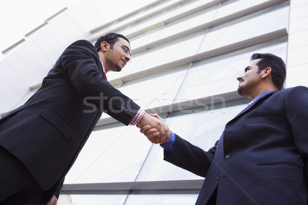 Stock photo: Two businessmen meeting outside office building