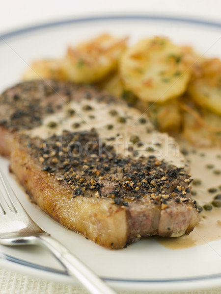 Stock photo: Steak au Poirve' with Saut Potatoes