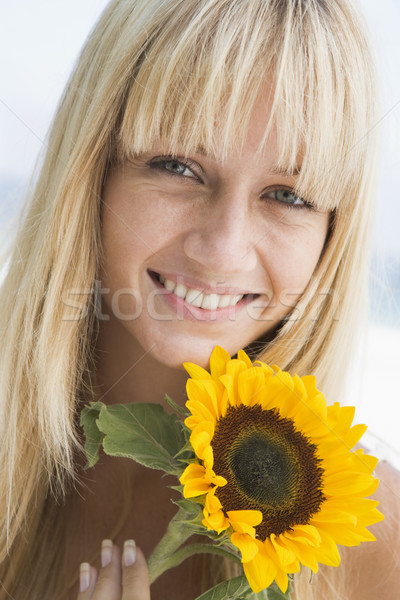 Stock photo: Woman holding sunflower