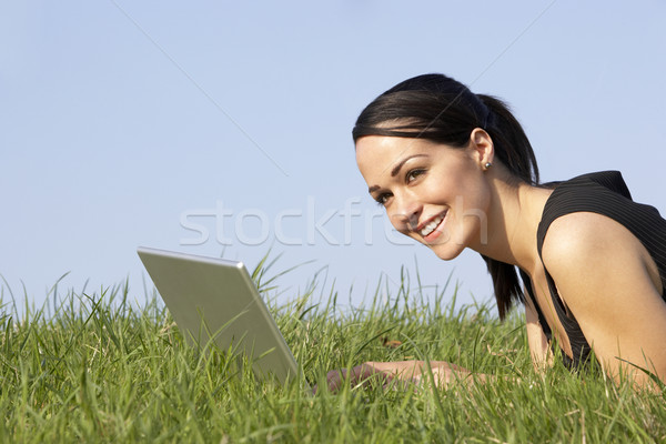 Stock photo: Woman Using Laptop Outdoors In Summer Countryside