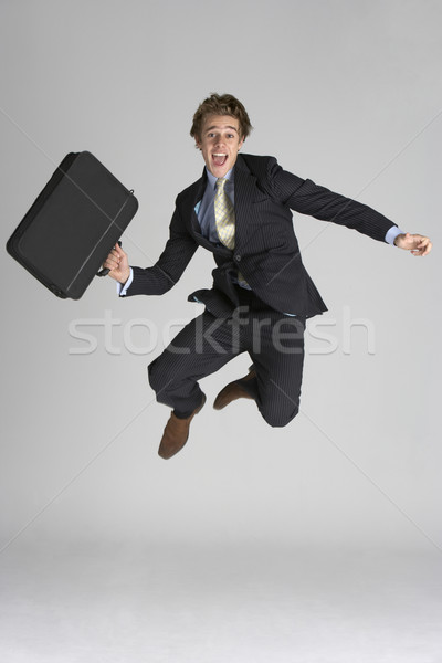 - 98070_stock-photo-businessman-jumping-in-air