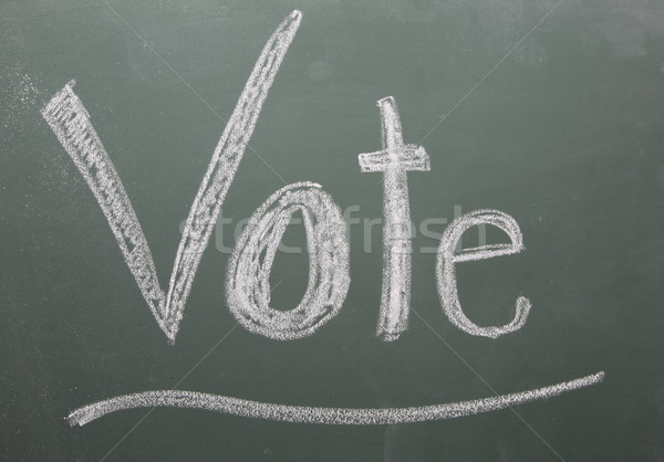 Stock photo: Vote Written on Blackboard