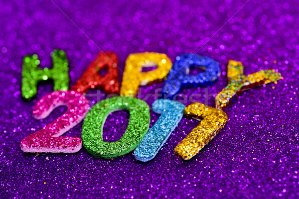 Stock photo: glittering letters forming the text happy 2017