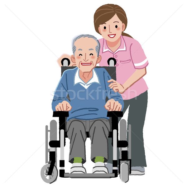 Portraits of smiling happy elderly man in wheelchair and his caregiver