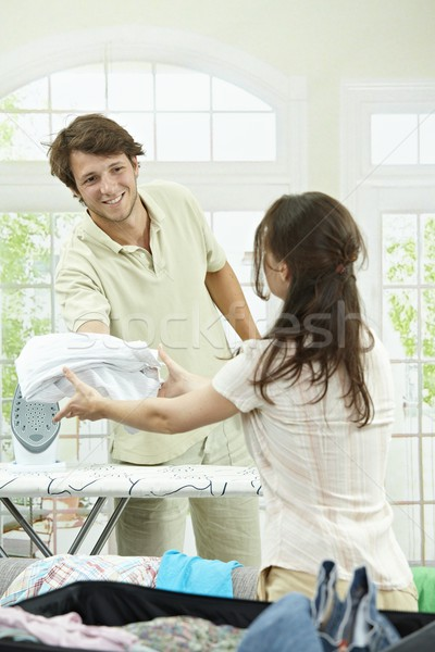 Stock photo: Couple packing for holiday