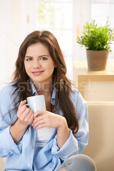 Stock photo: Young woman at home at morning